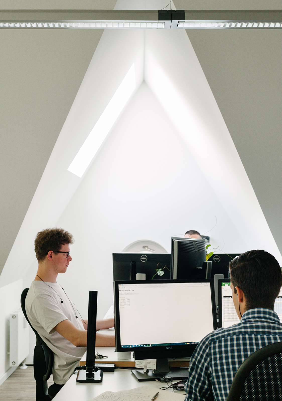 ctrl qs employees working at their desks in a bright office